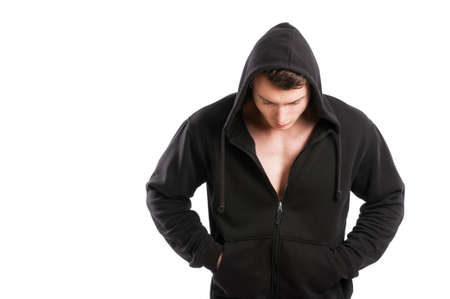 Male model wearing just black hoodie and looking down isolated on white background photo
