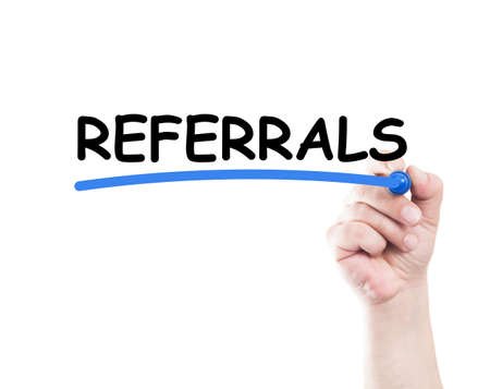 Referrals concept made by a human hand holding a marker on transparent wipe board photo
