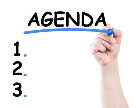 Agenda list concept made by a human hand holding a marker on transparent wipe board