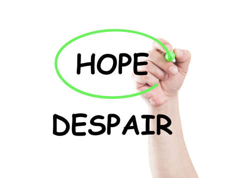 chose: Chose hope not despair concept made by a human hand holding a marker on transparent wipe board