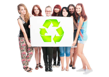 big girls: Group of girls holding a big white board with green recycling sign or symbol on it