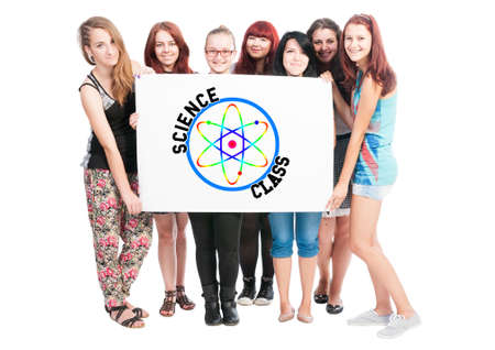 big girls: Group of girls holding a big white board with a science class and atom symbol concept on it