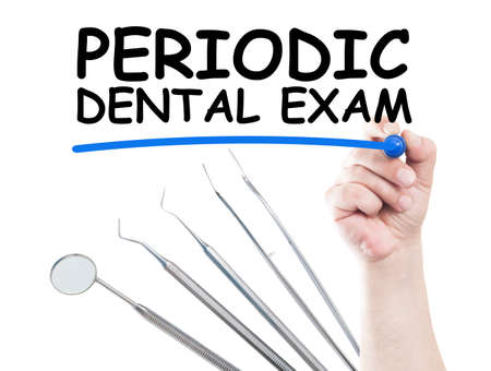 Periodic dental exam concept made on transparent wipe board with a hand holding a marker and usual dentist tools or instruments photo