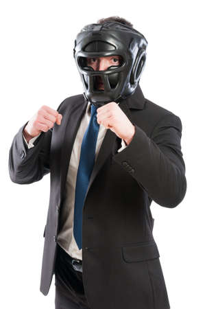 takeover: Businessman ready for takeover concept with male wearing protective boxing helmet