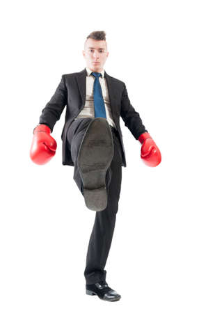 aggresive: Competitive and aggresive business man tread over the competitors concept on white background