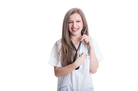 Woman doctor listening her own heart using stethoscope Stock Photo