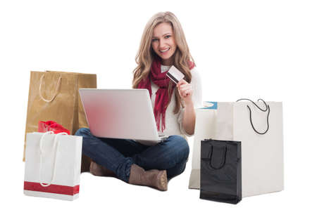 epayment: Satisfied shopping woman using credit or debit card to buy online. E-payment concept on white background Stock Photo