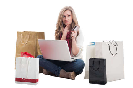 epayment: Spending money online using credit or debit card concept with a woman holding a laptop ready to spend money on e-shops