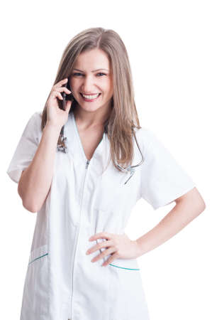 Woman doctor talking on smartphone. Friendly contact us concept on white background photo