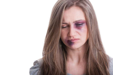 Domestic violence victim concept with a beaten woman portrait