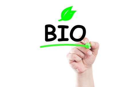 eco slogan: Bio concept text write on transparent wipe board by hand holding a marker