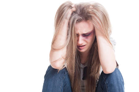 beaten woman: Domestic violence and despair concept with an abused and beaten woman