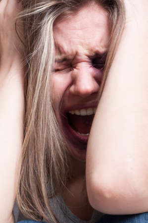 contusion: Domestic violence abuse concept with an injured woman screaming or yelling