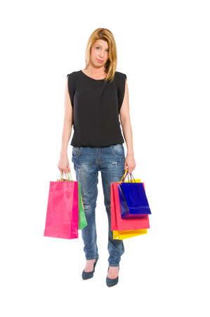 dissapointed: Sad and dissapointed shopping woman standing isolated on white backrgound