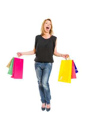 Shopping woman acting crazy isolated on white background photo