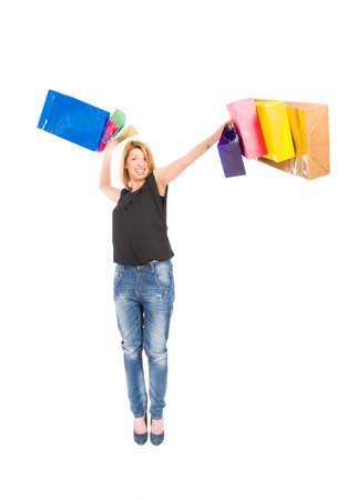 Hurl: Joyful shopping woman throwing shopping bags on white background