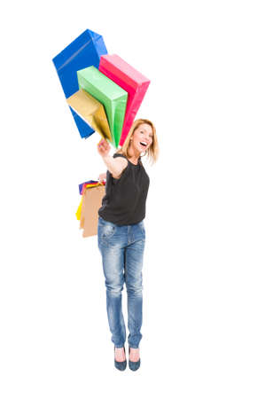 Hurl: Happy shopping woman throw shopping bags to the camera on white background