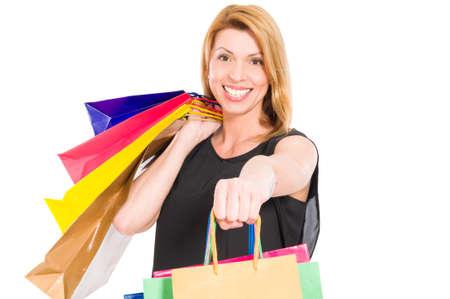 shopper: Cheerful female shopper smiling to the camera Stock Photo