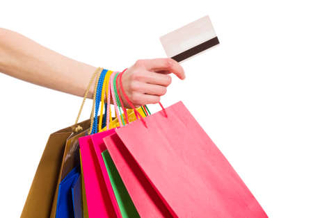 Woman hand with shopping bags and credit card on white background Archivio Fotografico