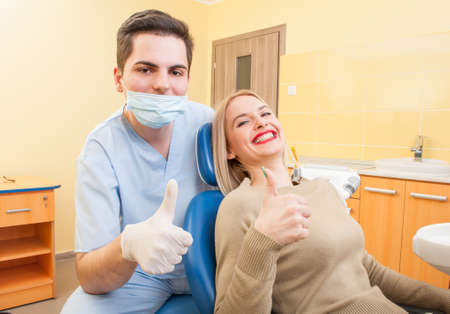 stomatologist: Dentist doctor and patient showing thumbs up. Frindly and confident doctor concept. Stock Photo