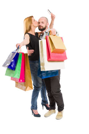 consumerism: Happy shopping couple using credit card. Consumerism relationship concept on white background