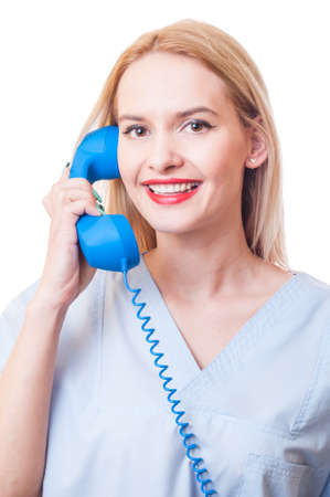 Call the hospital or clinic concept with a woman doctor holding and answering a phone photo