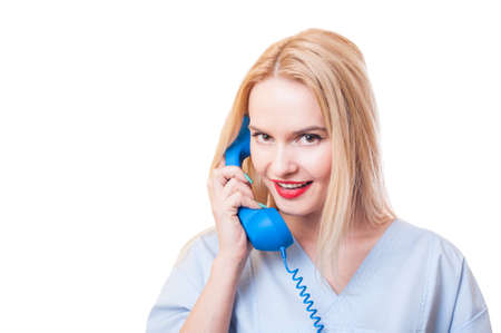 Beautiful woman hospital support concept with a female doctor talking on the phone photo