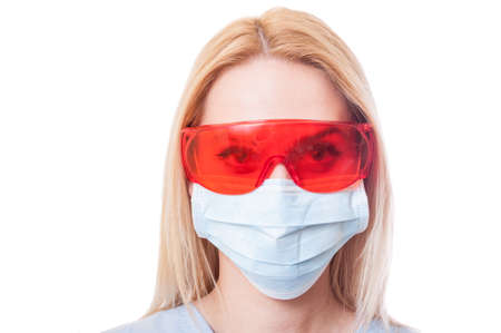 protective glasses: Face of a woman dentist doctor wearing protective glasses and mask