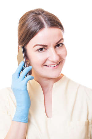 Medical assistant holding smartphone on white background photo