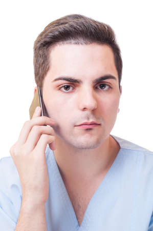 contactus: Portrait of a young male doctor talking on smartphone