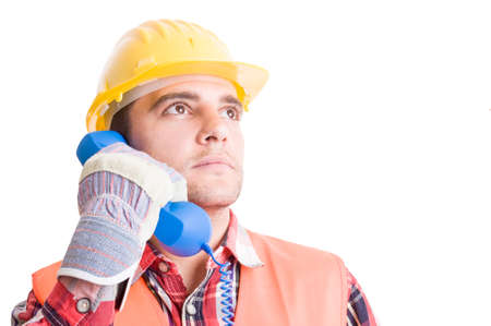 visionary: Visionary and confident builder talking on the phone and looking up Stock Photo