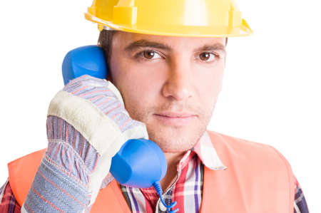 costruction: Costruction worker or builder talking on the phone classic telephone Stock Photo