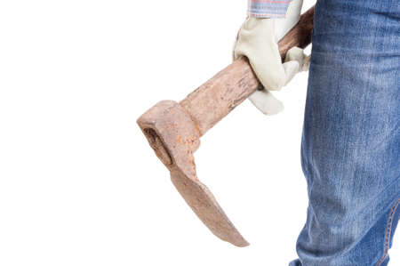 mattock: Gardener or constructor holding a hoe on white background with copyspace