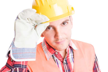 Polite builder geeting by touching his helmet on white background