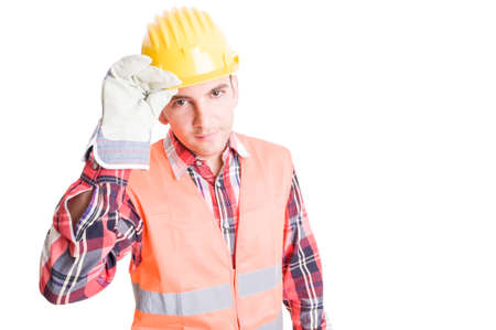 Polite constructor geeting by touching his helmet Stock Photo
