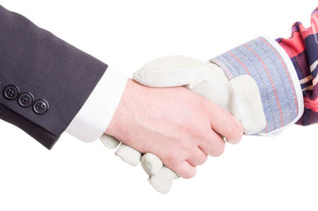 Professional builder wearing gloves and elegant suited business contractor hand shake photo