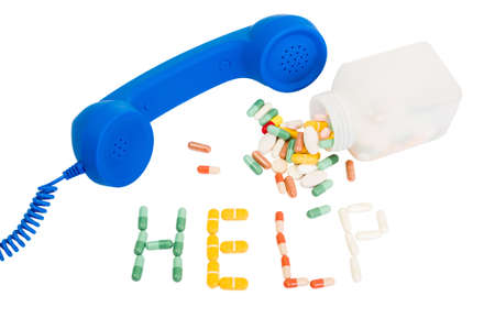 call for help: Pills addicted call for help concept with phone, medicine and the word help made from pills