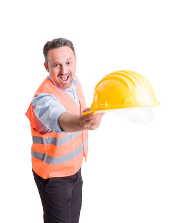 Foreman or engineer throwing hat on studio white background