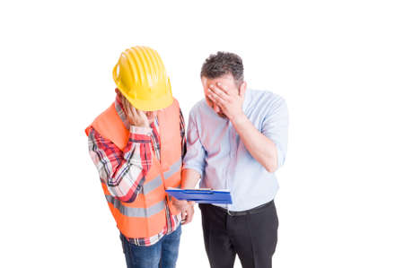 Stressed engineer and upset builder checking clipboard. Construction concept on white background