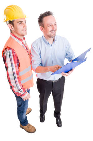 taskmaster: Happy contractor and construction worker holding clipboard Stock Photo
