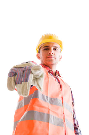 low  angle: Low angle builder pointing finger to the camera on white background