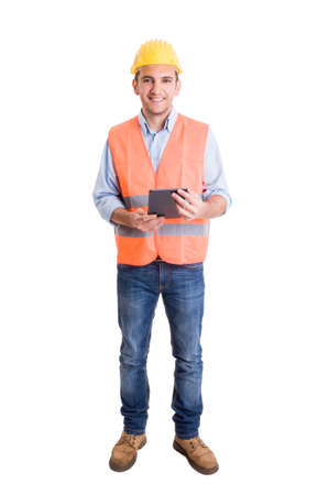 Full body of a modern engineer on white background holding a wireless tablet