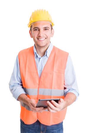 ingeniero: Ingeniero Moderno y confía en la celebración de la tableta y sonriendo a la cámara Foto de archivo