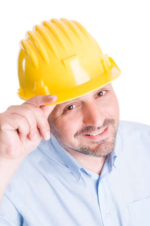 salutation: Polite engineer or architect touching helmet as salutation Stock Photo
