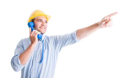 visionary: Visionary architect talking on phone and pointing finger up showing something