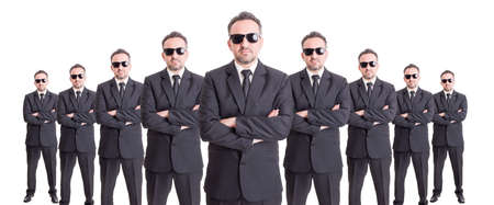 organized group: Organized group of business people standing with confidence on wide image Stock Photo