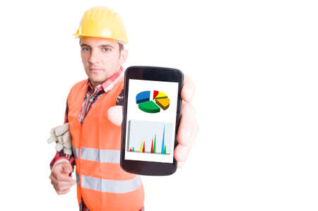 Builder or construction worker showing smartphone with financial charts Standard-Bild