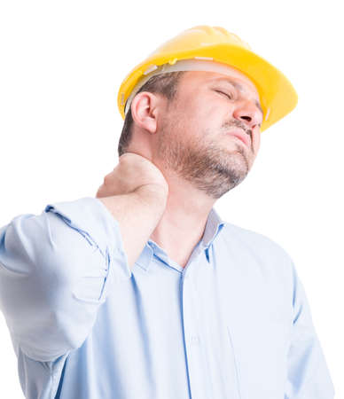 Back neck pain gesture by tired and exhausted architect or engineer Standard-Bild