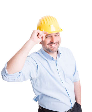 salut: Smiling engineer or architect greeting gesture by touching or lifting his yellow helmet Stock Photo