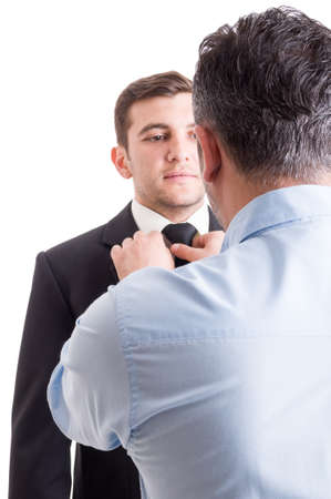 taylor: Handsome male model getting prepared for photo shooting by the art director or fashion designer